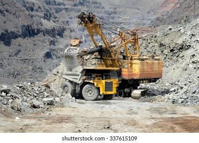 Kremenchug, Ukraine - 26 June 2010. Heavy mining dump truck being loaded with iron ore