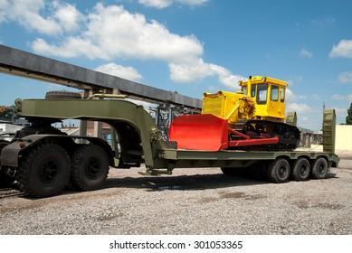 Kremenchug, Ukraine - 27 June 2008. Transportation of heavy caterpillar bulldozer on a trailer.