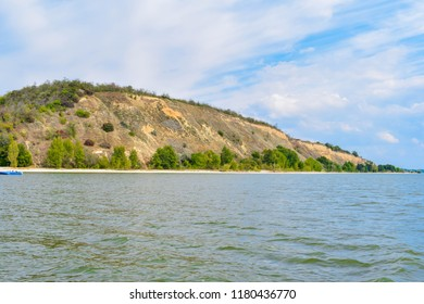 KREMENCHUG, UKRAINE - A cliff mountain on the shore of a reservoir
