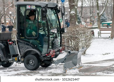 """Kremenchug, Ukraine - January 19, 2018: snow-removing machine """"Karcher"""" cleans the paths in the city park from the snow"""