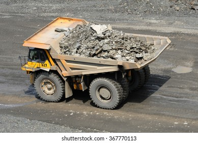 Kremenchug, Ukraine - June 26, 2010. Dump truck driving on a road in a stone quarry.
