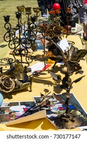 Kremenchug, Ukraine- June 3, 2017: Various forged iron products for sale during Strawberry festival