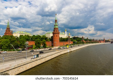 Kremlin and the Kremlin embankment in summer against the background of the cloudy sky. Thunderclouds