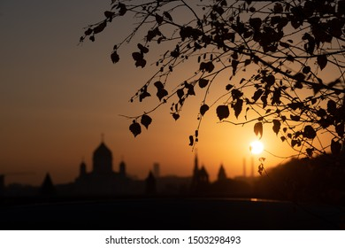 Kremlin silhouette view at sunset in Moscow, Russia. Dormition orthodox cathedral in the middle with other bell towers and towers on the sides. Architecture and travel concepts