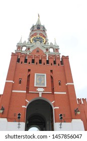 Kremlin Spasskaya tower low angle view on Red square in Moscow, Russia. Kremlin building facade with entrance to Kremlin Palace on summer day
