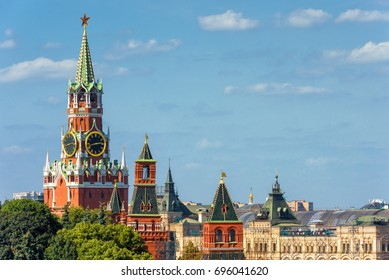 Kremlin with Spasskaya tower, Moscow, Russia. Kremlin is the residence of Russian president and the main landmark of Russian capital. Ancient Kremlin in the sunlight. Kremlin postcard with copy space.
