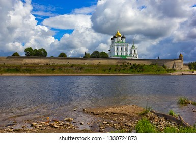 Kremlin and Trinity cathedral seen across water in Pskov, Russia