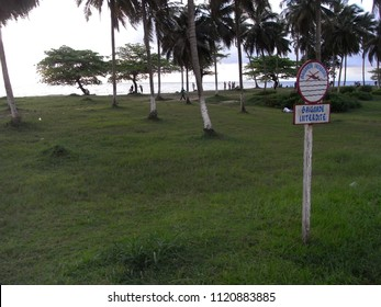 KRIBI,  CAMEROON,  AFRICA - CIRCA SEPTEMBER 2010  : View of BEACH SIDE and NO SWIMMING SIGN.