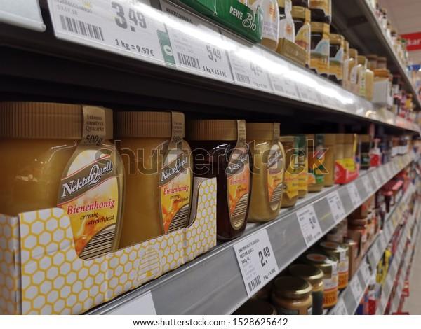 Kriftel / GERMANY, September 28, 2019: a shelf with glasses of honey in a German supermarket.