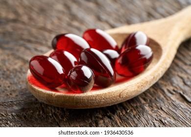 Krill oil pills on a spoon, closeup