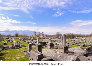 KRINIDES, GREECE - FEBRUARY 25, 2010: Ruins of the corinthian north-east temple next to the forum and the Basilica B church in the background, at Philippi