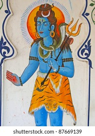 Krishna with serpent and trident, temple painting in  Udaipur, India