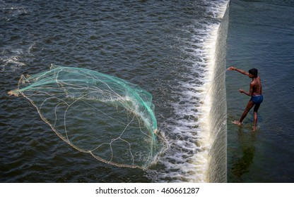 KRISHNAGIRI, TAMIL NADU, INDIA, JULY 03, 2016 :  Unidentified fisherman throwing his cast net on 03 July 2016 in KRP Dam, India.