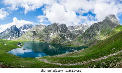 Krishnasar and Vishnusar lakes on the Kashmir great lakes trek in Sonamarg, India. Rocky terrain and turquoise lake/tarn with snow mountains and glacier. Most serene trek in the Himalayas.