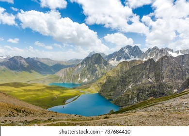 Krishnasar and Vishnusar lakes on the Kashmir great lakes trek in Sonamarg, India. Amazing beauty of Nature. Turquoise lakes/Tarns. Blue sky and white clouds. Wanderlust, hiking, trekking in mountains