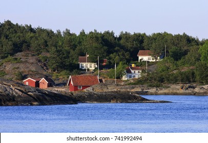 KRISTIANSAND ARCHIPELAGO, NORWAY ON JULY 02. View of the Norwegian archipelago in evening lit, islands and summer houses on July 02, 2009 in Kristiansand, Norway.