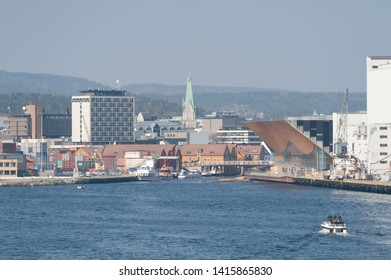 Kristiansand , Norway - April 22 2011: Seaside view of Kristiansand Skyline with the Caledonien hotel, Kristiansand Cathedral and  Kilden Performing Arts Centre.
