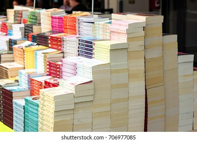 Kristiansand, Norway - August 16, 2017: Travel documentary of stack of paperback books on sale outside book store.