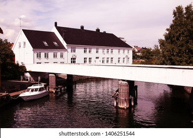 Kristiansand, Norway. Capital of Vest-Agder county. White swan in the harbor.
