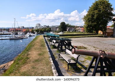 Kristiansand, Norway. Capital of Vest-Agder county. Cannons at the coastal fort. Marina in background.