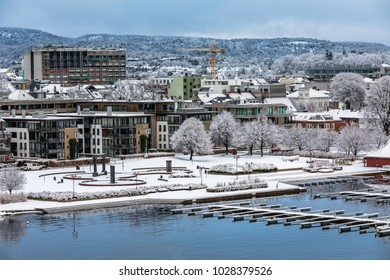 Kristiansand, Norway - January 17, 2018: The Otterdals Park covered in snow. The water fountain on the harbor of Kristiansand was created by the artist Kjell Nupen.