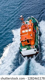 Kristiansand, Norway - July 19, 2017: A pilot boat is sailing at high speed to a ship at sea to bring the pilot on board to support the entry into the port of Kristiansand.