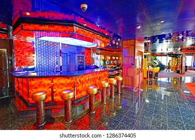 Kristiansand, Norway - July 19, 2017: Colorful bar in the entertainment area aboard the cruise ship Costa Favolosa of the shipping company Costa Crociere