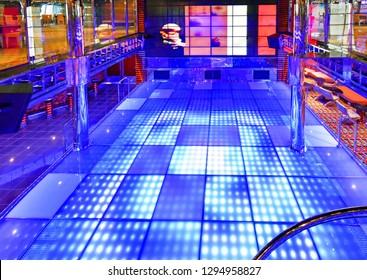 Kristiansand, Norway - July 19, 2017: Illuminated dance floor of the Etoile nightclub aboard the cruise ship Costa Favolosa of the shipping company Costa Crociere