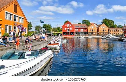 Kristiansand, Norway - July 19, 2017: Motorboats navigate on a canal in the Fiskebrygga district in Kristiansand, Norway.