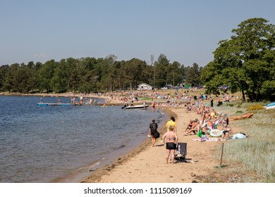 Kristiansand, Norway - June 3, 2018: Many people at the Hamresanden beach, on a very hot sunday in the summer.