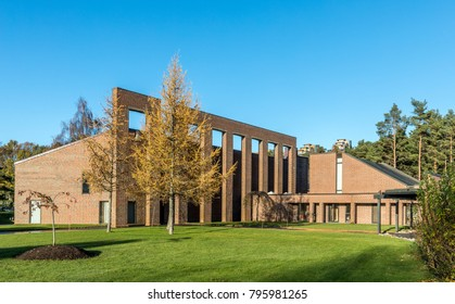 Kristiansand, Norway - November 14, 2017: Chapel and crematorium in Oddernes, Kristiansand, with trees, grass and blue sky in autumn, Kristiansand, Norway