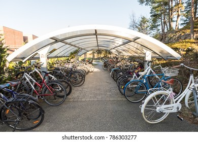 Kristiansand, Norway - November 5, 2017: Bike shed with bikes at the University of Agder, UiA, in Kristiansand.