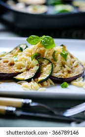 kritharaki with fried zucchini and aubergine slices