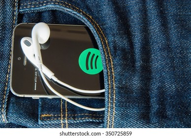 KRIVOY ROG, UKRAINE - december 12, 2015: iPhone 5s with mobile application for Spotify on the screen in dark blue jeans pocket