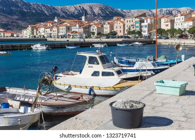 BAŠKA, KRK / CROATIA -  FEB 3 2019: Baška is also recognizable as having one of the largest and most beautiful pebble beaches on the Adriatic, which is in a semicircle and more than 1800 metres long.