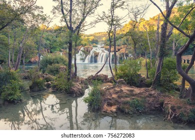 Krka National Park, nature landscape, view of the waterfall Skradinski buk and river Krka through the bizzare trees, Croatia