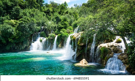 Krka waterfalls in Croatia with crystal clear water and bountiful leaves