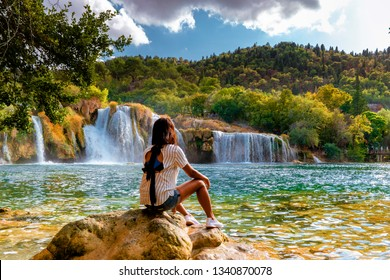 KRKA waterfalls Croatia, krka national park Croatia on a bright summer evening, woman relaxing in the park