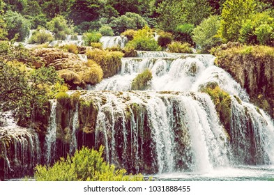 Krka waterfalls. Croatian national park. Beautiful natural scene. Flowing water and greenery. Croatia, Europe. Beauty photo filter.