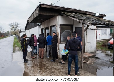 Krnjaca, Belgrade, Serbia. 11/16/17. A group of unregistered asylum seekers line up to eat a meal given by the Krnjaca refugee camp