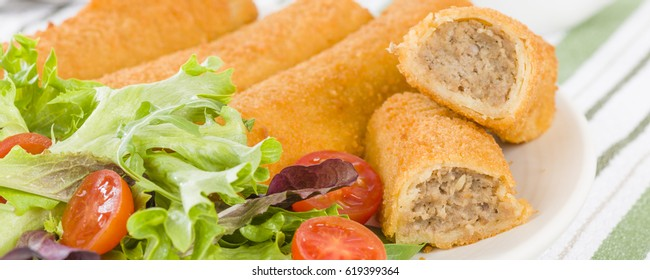 Krokiety - Polish style croquettes filled with beef served with salad.