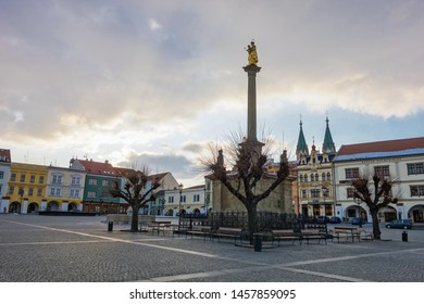 KROMERIZ, CZECH REPUBLIC - FEBRUARY 24, 2018: Empty Big town square (Velke namesti) in Kromeriz city with Saint Mary statue in late afternoon with storm coming