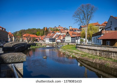 KRONACH, GERMANY - CIRCA APRIL, 2019: Townscape of Kronach with Hasslach river in front of fortress Rosenberg, Bavaria, Germany