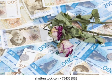 Krone Banknotes. Norwegian Krone Currency and old flowers