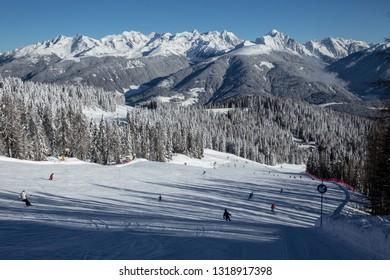 Kronplatz in Eastern Tirol. Italy. Ski slope and mountains in background.
