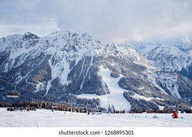 Kronplatz, Italy, 2018: Beautiful view of valley and peaks in Italian Dolomites from the wide ski slope, photo taken in beautiful cloudy winter day