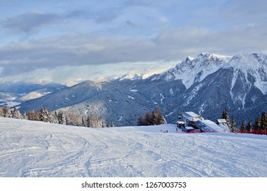 Kronplatz, Italy, 2018:  Great ski slope in the ski resort in Italian Dolomites, photo taken in a beautiful nature during sunny winter day, high peaks in the background
