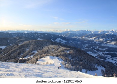 Kronplatz, Italy, 2018: Panoramic view of the ski slope landscape from the top, sunny winter day