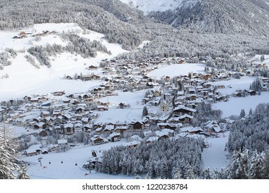 Kronplatz, Italy, 2018: Panoramic view of the mountain village in a snowy valley in Italian Dolomites