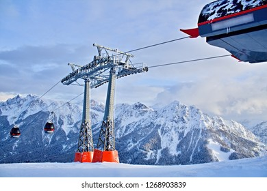 Kronplatz, Italy, 2018: Upper station of a cableway, high mountain peaks in the background, photo taken in beautiful sunny day